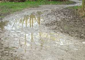New path awash with mud and standing water 